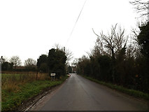 TL3656 : Entering Toft on Hardwick Road by Adrian Cable
