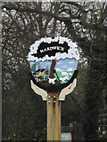 TL3758 : Hardwick Village sign by Adrian Cable