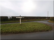 SJ5050 : Finger-post at Ashtons-cross by John Lord