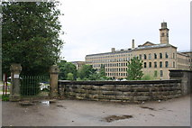 SE1338 : Salt's Mill and entrance to Roberts Park from Saltaire Bridge approach by Roger Templeman