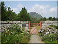 J3021 : Small style Belfast & District Water Commissioners gate in the gardens below the Silent Valley Dam by Eric Jones