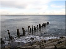 J3731 : Groyne at the mouth of the Shimna River by Eric Jones