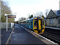 SJ3043 : A Holyhead Bound train pauses at Ruabon Station by John Lucas