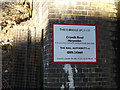 TL1413 : Bridge sign on Cravells Road Railway Bridge by Geographer