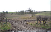 TA0779 : Muddy field entrance off Flotmanby Lane (A1039) by JThomas