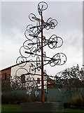 SE2932 : Bicycle wheel sculpture, Foundry Square, Leeds by Stephen Craven