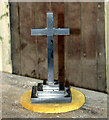TF8915 : Small wooden cross in St Mary's church by Evelyn Simak