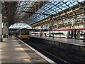 SJ8497 : Manchester Piccadilly: Northern Rail and Virgin trains by Jonathan Hutchins