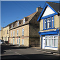 TL5686 : Littleport: yellow brick, blue sky and blue paint by John Sutton