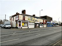 SJ9495 : Shops on Manchester Road by Gerald England