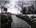 SJ9594 : Icy footpath from Morrisons by Gerald England