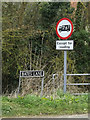 TM0683 : Bates Lane sign & roadsign by Adrian Cable