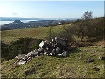NS4275 : Rubble at the foot of Dumbowie Hill by Lairich Rig