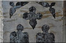 TG2834 : Trunch: St. Botolph's Church: Inlaid flint flushwork on the font by Michael Garlick