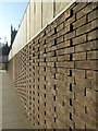 SO8454 : Brick patterns in a wall by Philip Halling