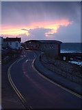 SW3526 : March sunset behind the Lifeboat Station by Rod Allday