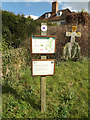 TM1354 : Footpath Signs at St.Mary's Church by Adrian Cable