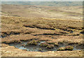NN1722 : Peat haggs below Coire an Stacain by Trevor Littlewood