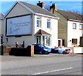 SS5598 : JCDecaux advertising site on a Heol-y-bwlch house side wall, Bynea by Jaggery