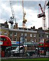 TQ3276 : White, yellow and red tower cranes, Camberwell by Robin Stott