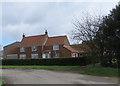 TA2137 : Farmhouse with window cleaner, West Newton by Paul Harrop
