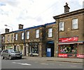 SK0394 : Shops on Henry Street by Gerald England