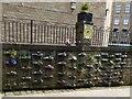 SK0394 : Smithy Fold Wall Bottle Garden by Gerald England