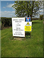 TM1256 : Signs at the entrance to Home Farm by Adrian Cable