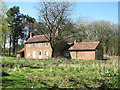 TG0530 : Farmworkers' cottages on the edge of Holmes's Wood by Evelyn Simak