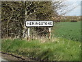 TM1552 : Hemingstone Village Name sign on Main Road by Adrian Cable
