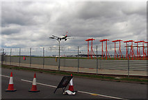 TQ0975 : Heathrow boundary fence and runway lights by Andrew Tatlow