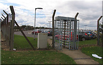 TQ0975 : Turnstile into some Heathrow car park space by Andrew Tatlow