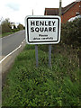 TM1652 : Henley Square Village Name sign on Ashbocking Road by Adrian Cable