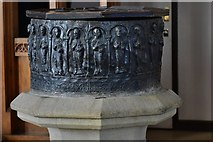 SK3463 : Ashover: All Saints Church: The rare Norman lead font; apostles holding books by Michael Garlick