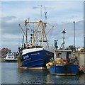 NU2232 : Fishing boats moored in North Sunderland Harbour, Seahouses by Robin Drayton