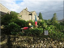 SD9772 : Scarecrows doing Yoga, Kettlewell by Graham Robson
