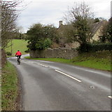 SO8700 : Cycling down Woefuldane Bottom near Minchinhampton by Jaggery
