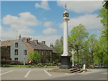 NY6820 : Appleby High Cross, with passing cyclist by Stephen Craven