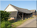 TL8437 : Cart Lodge at Gentrys Farm, Little Henny (listed building) by Roger Jones