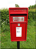 TM0157 : Post Office High Road Postbox by Adrian Cable