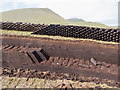HT9639 : Drying peat at the peat banks of Da Lieug by Julian Paren