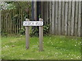 TL9863 : Church Road sign by Adrian Cable