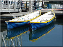 SW4628 : Blue and yellow boats, Newlyn Harbour by Chris Allen