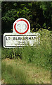 TM1048 : Little Blakenham Village Name sign by Adrian Cable