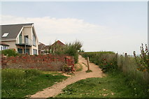 TQ4100 : Clifftop path and a wall with character in Peacehaven by Chris