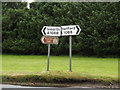 TL8979 : Roadsigns on the A1088 The Street by Adrian Cable