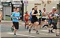SJ9594 : Hyde 7 Road Race: Runners on Market Street by Gerald England