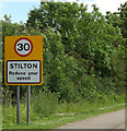 TL1690 : Stilton Village Name sign on North Street by Adrian Cable