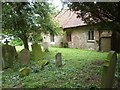 TL6010 : The South wall and Churchyard of All Saints church, Berners Roding, Essex by Derek Voller
