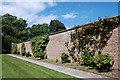 NJ7212 : Garden wall by Bill Harrison